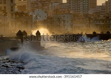Waves crashing along the Malecon, Havana, Cuba - stock photo