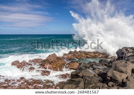 Waves crashing at Queen's Bath, Kauai, hawaii - stock photo