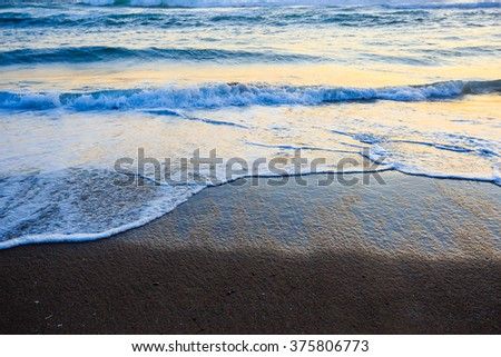 Waves crashing on an Oregon beach at sunset. - stock photo