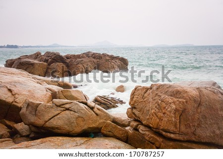 Waves crashing on rocks at coast in Thailand, Koh Samui - stock photo