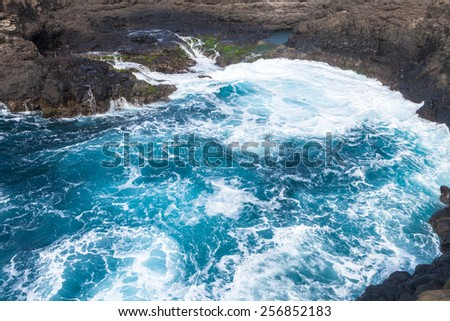 Waves crashing on the rocks of Sal island, Buracona - Cabo Verde - stock photo