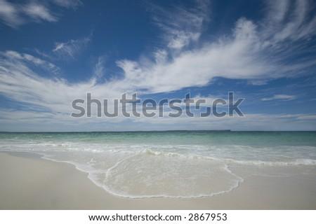 waves crashing onto a tropical beach - stock photo