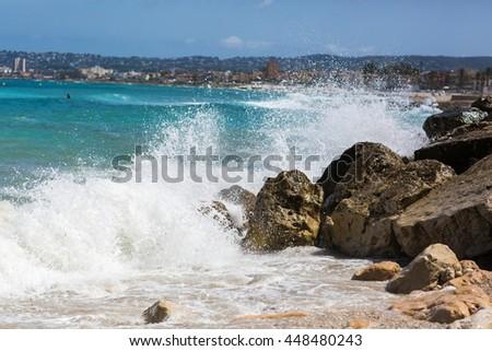 Waves hitting the rocks - stock photo
