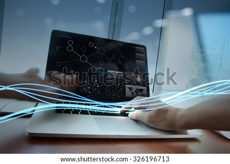 Waves of blue light and businessman using on laptop computer as concept                 - stock photo