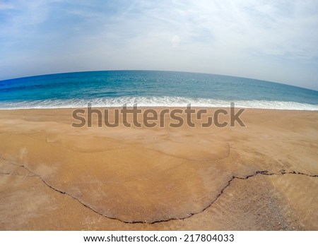 Waves on beach, Landscape (fish-eye lens) - stock photo