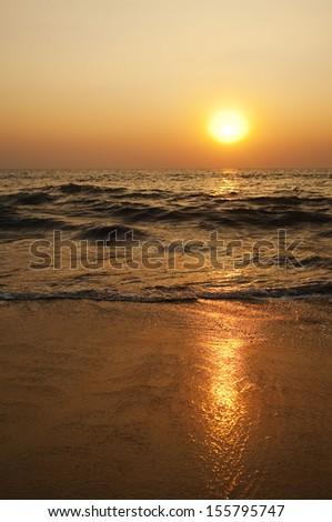 Waves on the beach at sunset, Goa, India - stock photo