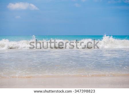 Waves on the sandy beach - stock photo