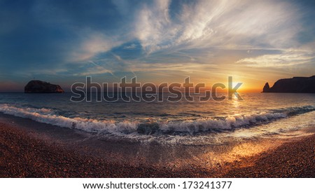 Waves on the seashore at sunset - stock photo