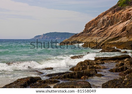 Waves pound the rocky Maine coast at Acadia National Park. - stock photo
