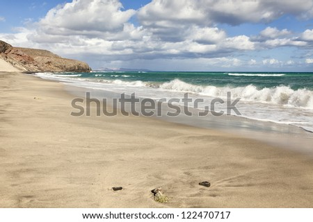 Waves rolling onto the empty beach Playa d'Esquinzo - stock photo