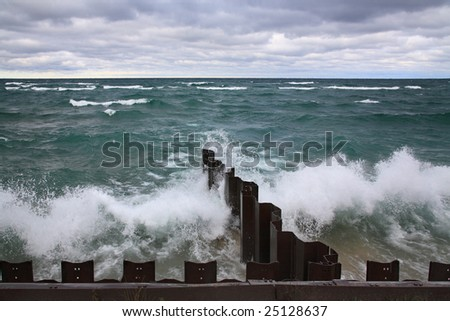 Waves Rolling Toward The Seawall At Point Betsie Lighthouse On Lake Michigan - stock photo