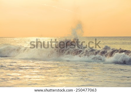Waves spraying mist into the air - stock photo