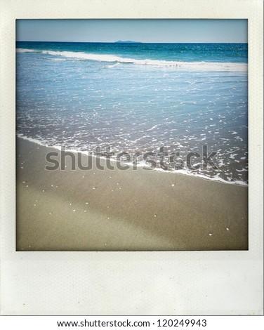 Waves wash up shoreline at beach - stock photo