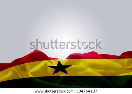 waving abstract fabric Ghana flag on Gray background - stock photo
