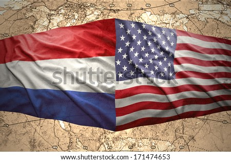 Waving American and Dutch flags on the background of the political map of the world - stock photo