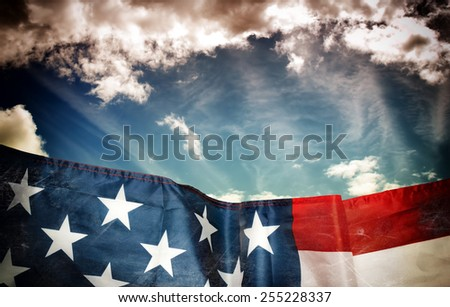 Waving american flag and sky in dark grunge style - stock photo