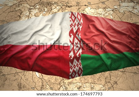 Waving Belorussian and Polish flags of the political map of the world - stock photo