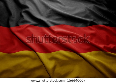 Waving colorful German flag - stock photo