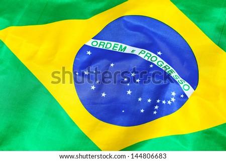 Waving Fabric Flag of Brazil - stock photo