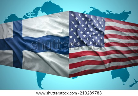 Waving Finnish and American flags of the political map of the world - stock photo