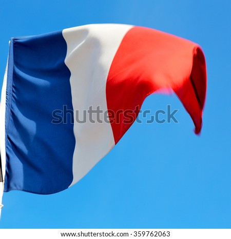waving flag in the blue sky  france colour and wave - stock photo