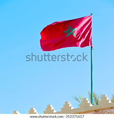 waving flag in the blue sky tunisia  colour and wave battlements - stock photo