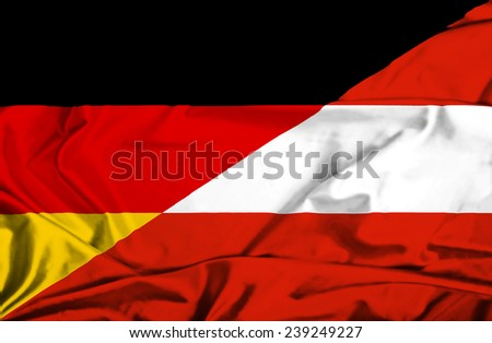 Waving flag of Austria and Germany - stock photo