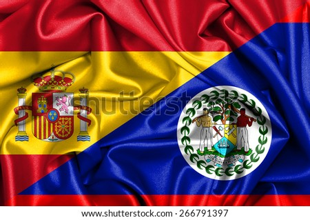 Waving flag of Belize and Spain - stock photo