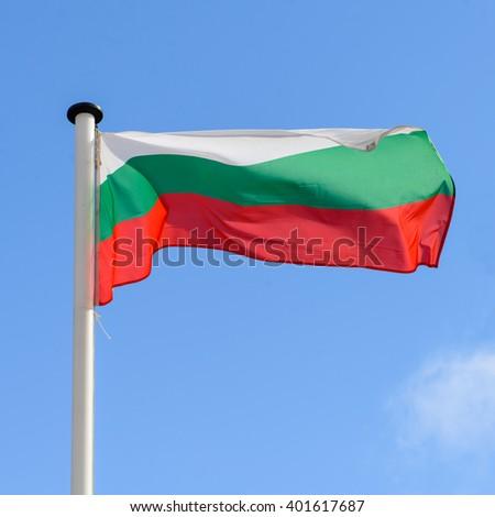 waving flag of Bulgaria against the blue sky - stock photo