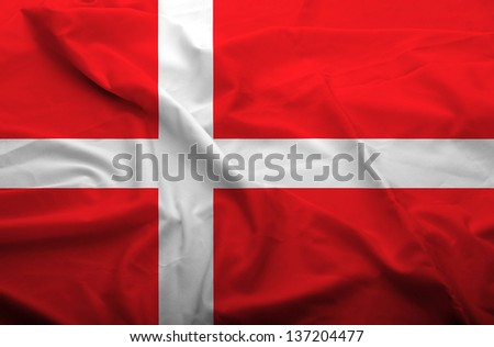 Waving flag of Denmark. Flag has real fabric texture. - stock photo