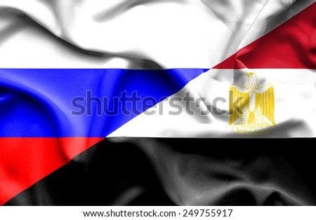 Waving flag of Egypt and Russia - stock photo
