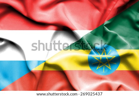 Waving flag of Ethiopia and Luxembourg - stock photo