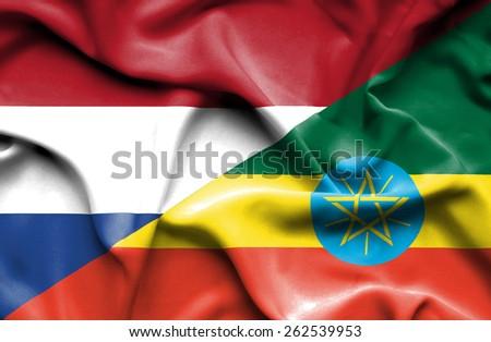 Waving flag of Ethiopia and Netherlands - stock photo