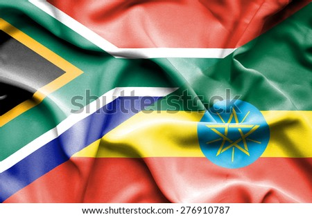 Waving flag of Ethiopia and South Africa - stock photo