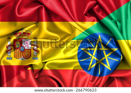 Waving flag of Ethiopia and Spain - stock photo