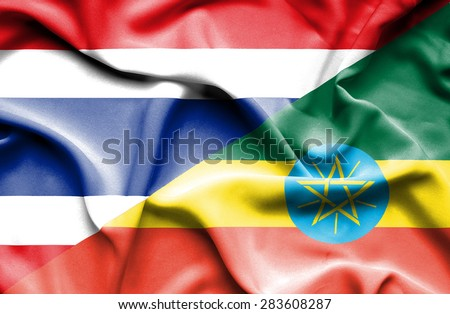Waving flag of Ethiopia and Thailand - stock photo