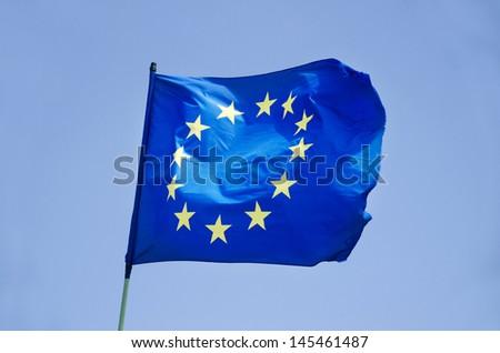 waving flag of European Union EU  against blue sky - stock photo