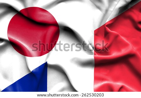 Waving flag of France and Japan - stock photo
