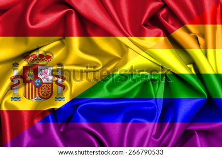 Waving flag of Gay and Spain - stock photo