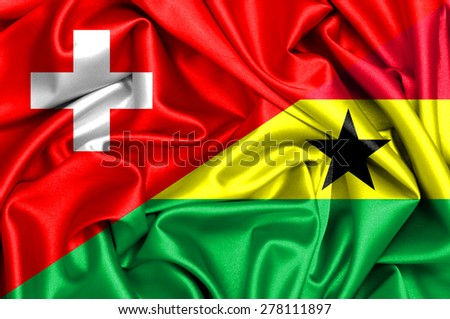 Waving flag of Ghana and Switzerland - stock photo