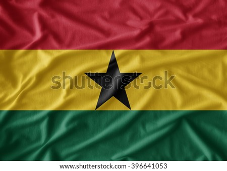 Waving flag of Ghana. Flag has real fabric texture - stock photo