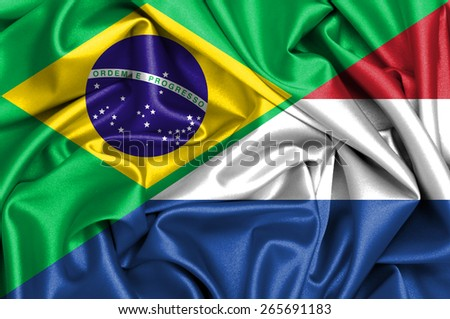 Waving flag of Holland and Brazil - stock photo