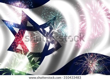 Waving flag of Israel  and festive firework   - stock photo
