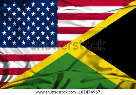 Waving flag of Jamaica and USA - stock photo