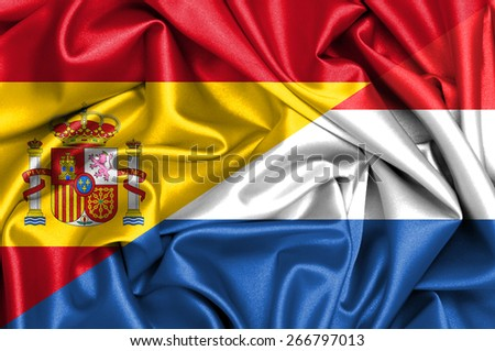 Waving flag of Netherlands and Spain - stock photo