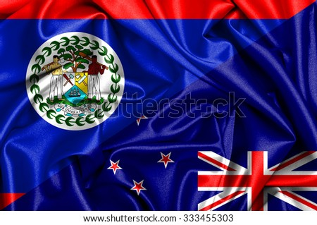 Waving flag of New Zealand and Belize - stock photo