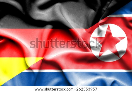 Waving flag of North Korea and Germany - stock photo