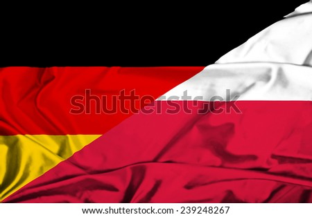 Waving flag of Poland and Germany - stock photo