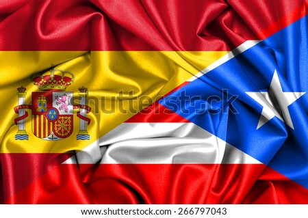 Waving flag of Puerto Rico and Spain - stock photo