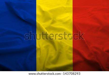 Waving flag of Romania. Flag has real fabric texture. - stock photo